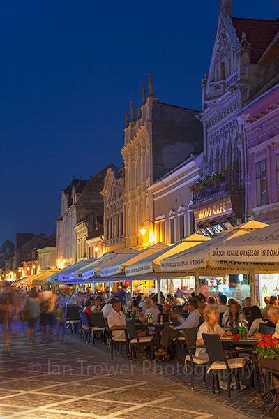 Outdoor cafes at dusk, Brasov