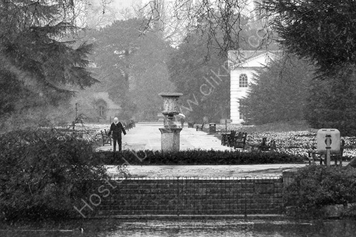 HC. Old man braves the snow Kew Gardens