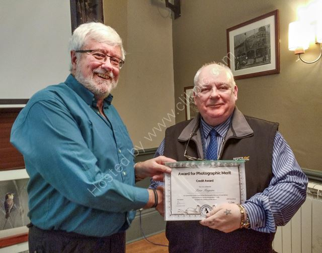 Peter Maguire receiving his CPAGB award from Jim Welsh