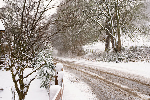 Snowy road by Ullswater