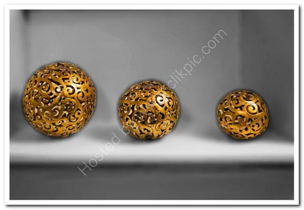 Ornamental brass orbs