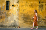 Lady at Yellow Wall