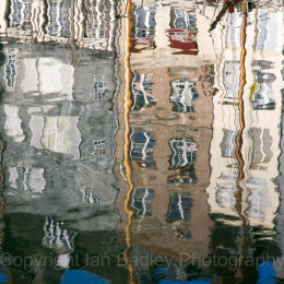 Square reflections of town houses in the old port of Honfleur, Normandy, France