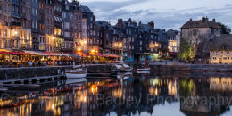 Sailing boats moored at the old port of Honfleur, Normandy, France, at dusk