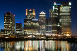 Reflected light of Canary Wharf at night, London, England