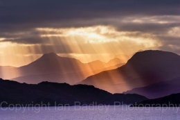 Sun shafts through storm clouds on Loch Torridon, Highlands, Scotland