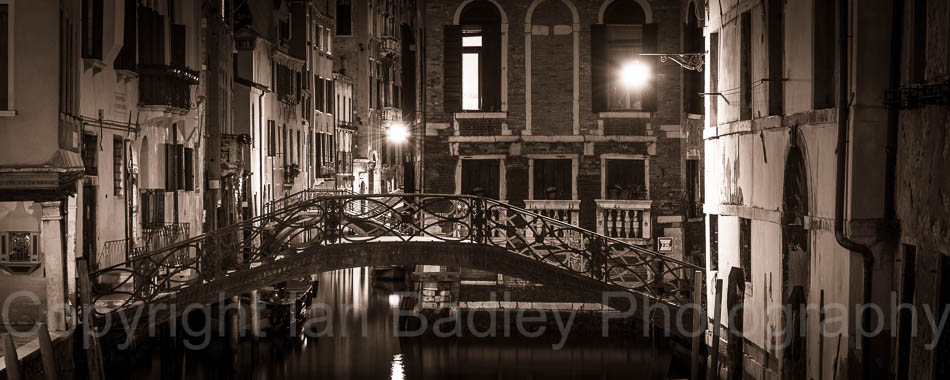 Bridge over a canal at night in Venice, Italy