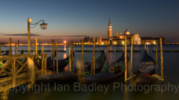 Dawn twilight over gondola and Saint Georgio, Venice, Italy