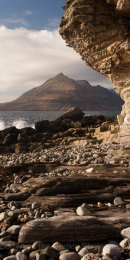 Smooth rocks and shaped cliff overlooking the sea and Cuillin Mountains at Elgol on Isle of Skye, Scotland