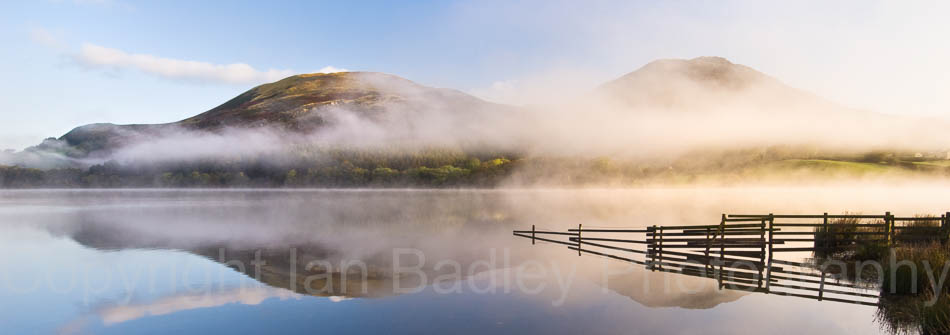 Mist rising at sunrise on Loweswater, Lake District National Park, Cumbria, England