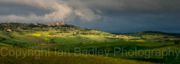 Storm clouds and sunlight on Pienza, Tuscany, Italy