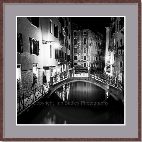 Black and white Venice canal at night