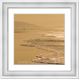 Lone woman on golden Harris beach