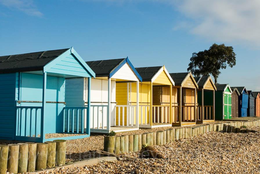Colourful beach huts at Calshot, Hampshire, England