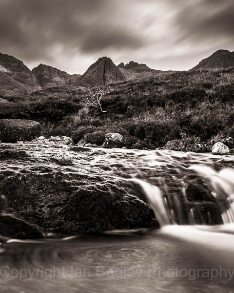 Swirling fairy Pools and Cuillin Hills, Isle of Skye, Scotland