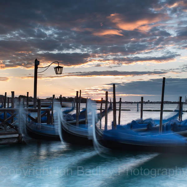 Moving Gondola, at sunrise, Venice, Italy