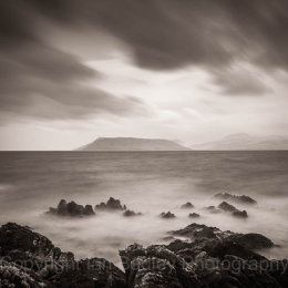Rocks and ethereal sea overlooking the Isle of Arran, Scotland