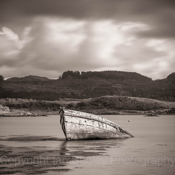 Sunken wooden boat on the west coast of Scotland