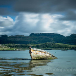 Sunken wooden boat on the west coast of Scotland