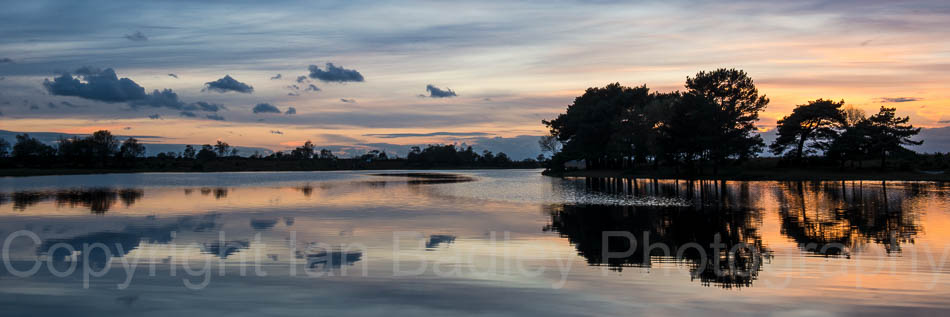 Cloud reflections in Hatchet Pond, Beaulieu, New Forest National Park, Hampshire, England