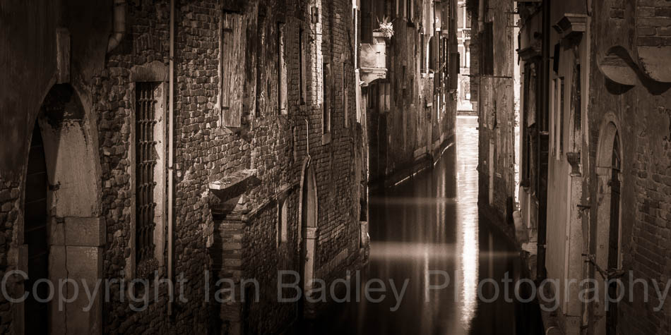 Light in a dark canal, Italy, Venice