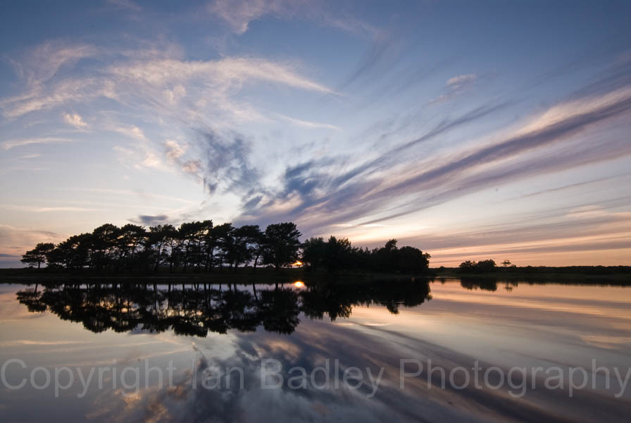6516c - Wierd cloud formation reflections at sunset  at Hatchet Pond, Beaulieu, New Forest National Park, Hampshire, England