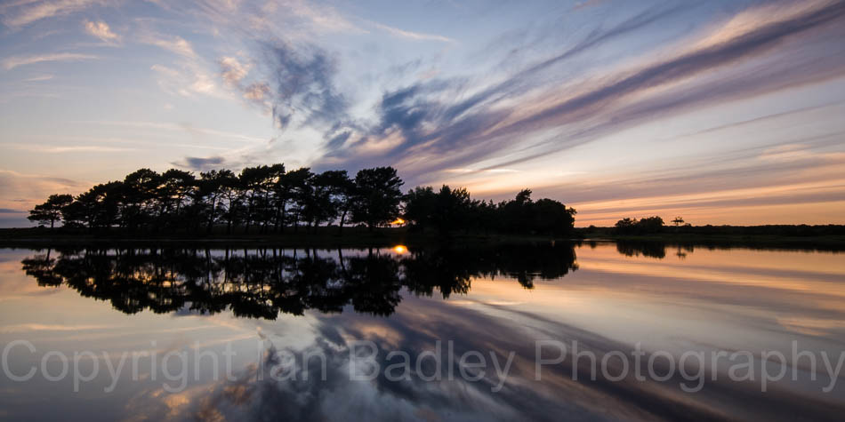 Wierd cloud formation reflections at sunset  at Hatchet Pond, Beaulieu, New Forest National Park, Hampshire, England