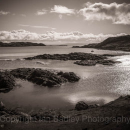 Moored yacht in a quiet bay on the Isle of Harris, Scotland