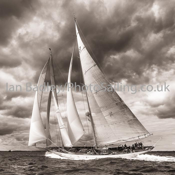 Classic yacht 'Adela' against a stormy sky