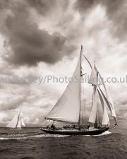 Classic yachts against a stormy sky