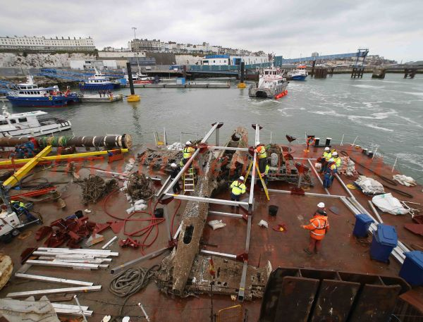 PICS SHOWS;The Dornier Bomber Found on the Goodwin Sands of the coast of kent ,Is brought into Ramsgate Harbour Today on a Barge to be renovated by the Air Force Museum