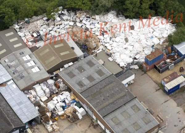 PICS SHOWS ; A mountain of Old Matresses Have appeared on a industrial Estate in the Pretty Village of  Smarden Kent , The Matresses are piled 25 foot high .