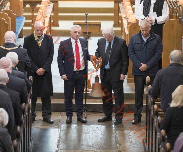 PICS SHOWS :Zeebrugge memorial service in Dover . The Bell from the Herald of Free Enterprise is handed over to Brian Gibbons (silver Hair)last survivor from the Herald