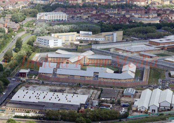 PIC SHOWS:-Aerial views of the Belmarsh prison facilities, located in the Thamesmead area of the Royal Borough of Greenwich, in south-east London, England. The large walled compound is HM Prison Belmarsh is a Category A men's prison. The smaller walled compound is HM Prison Belmarsh West, a category B mens prison. The 2 separate blocks make up HMP/YOI ISIS, which  is a young adult and category C training prison for young men and adults up to the age of 25. The prison is within the perimeter of HMP Belmarsh and comprises two house blocks each with four spurs of three landing.