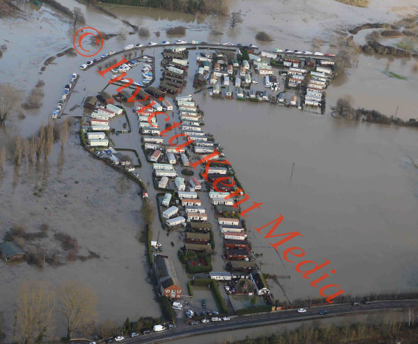 PICS SHOWS;Yalding in Kent still surrounded by Flood water with heavy rain and Flooding Due This evening. Little Venice static Mobile Home site Still under water with Yalding in The Background