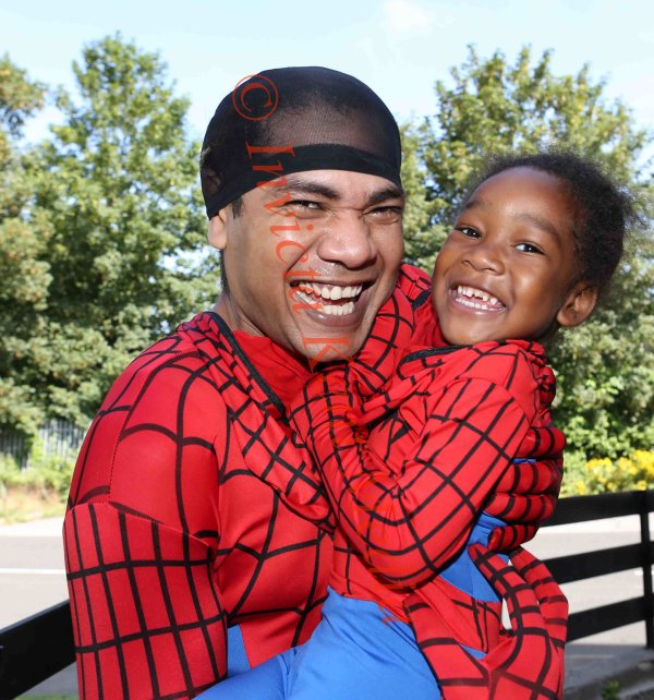christopher Lee and his son christopher jar age3yrs seen outside there flat in Orpington Kent chris dresses as Spiderman for his son the young baby is xiong age 18months 22.7.14