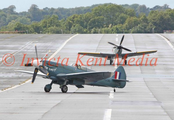 PIC SHOWS:-  A pair of Supermarine Spitfires on the Biggin Hill runway, a PR19 in front with an LF16 behind.