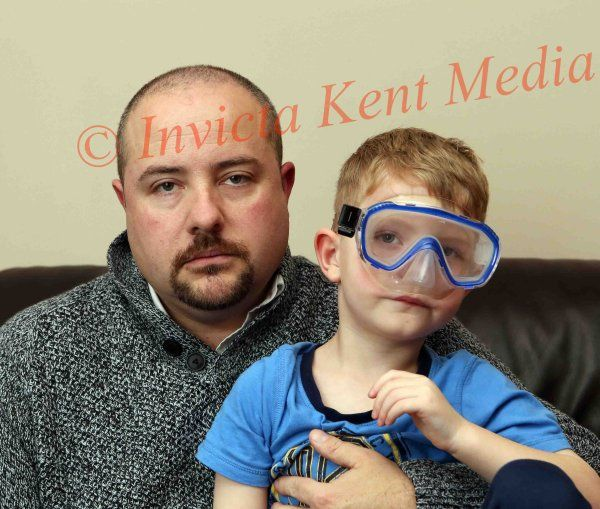 PICS SHOWS;Kevin Morris with son Toby age 5yrs at there Home in Tunbridge Wells Kent Seen Holding the Swimming Goggles that caused the Dispute At Tunbridge Wells Swimming Pool.