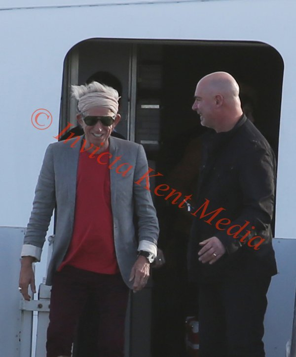PICS SHOWS;part of the rolling stones group Charlie Watts And Keith Richards arrive at Manston Kent Airfield after abandoning their tour.