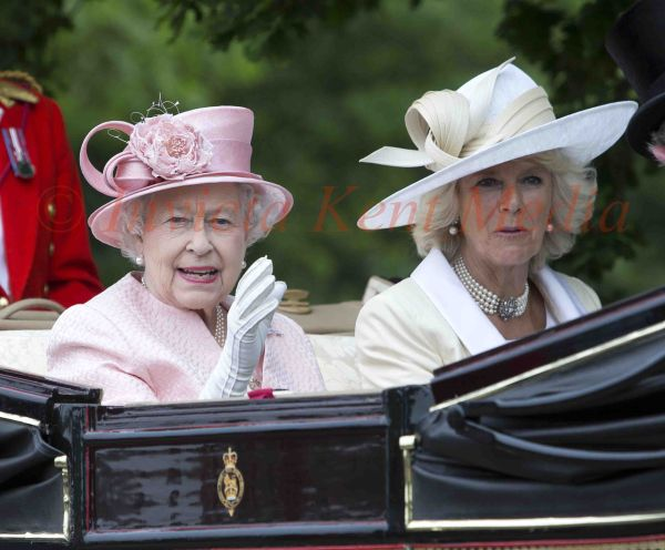 PICS SHOWS;The Royal carriage procession on its way to Ascot Races.The Queen and Camilla Ride Together