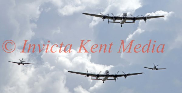 the only 2 airworthy avro lancasters in the world, escorted by 2 spitfires, seen over Biggin Hill, Kent