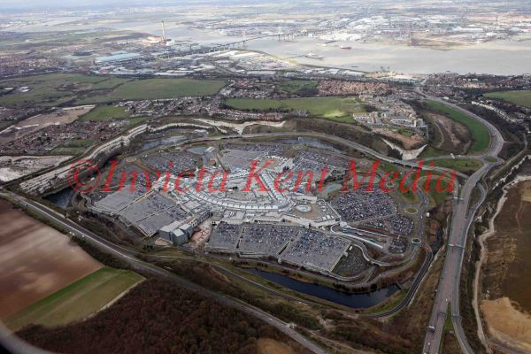PIC SHOWS AERIAL PIC OF BLUEWATER SHOPPING CENTRE WITH THE DARTFORD BRIDGE CROSSING IN THE BACKGROUND