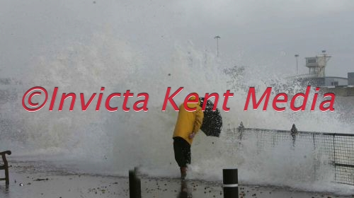 PIC SHOWS ;STORMS RAGE IN KENT AREA;A PEDESTRIAN GETS KNOCKED OVER BY STRONG WAVES WHILE WALKING ALONG DOVER SEAFRONT