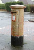 PIC SHOWS- Vandals have painted the post box in West Kingsdown, Kent, gold in honour of Lizzie Yarnolds Gold medal at the olympics, after the post office refused to do so.