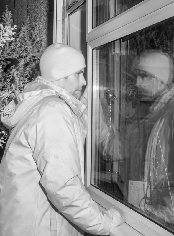 Simulation of burglar attempting to enter house, shot with IR camera
