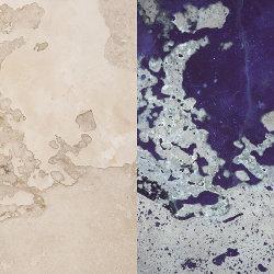 Travertine floor tile fluorescing in UV.