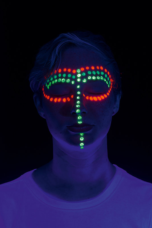 Face Paints fluorescing in UV