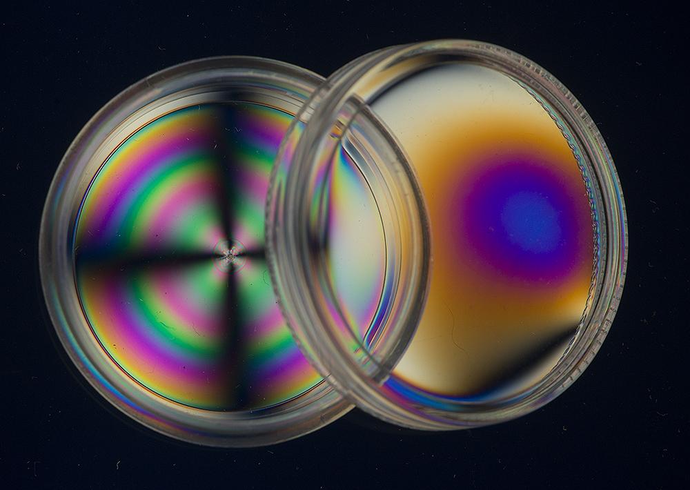 Plastic pot and lid  in polarised light