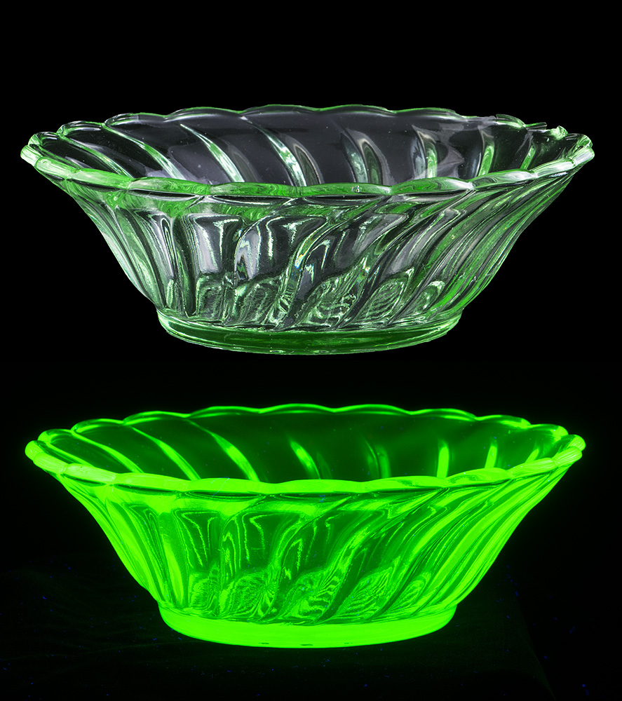 An example of Uranium glass from the 1920's, fluorescing in UV radiation