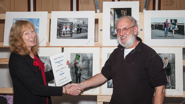 Ian receiving their 2nd place certificate from judge, Anne Sutcliffe FRPS EFIAP PPSA